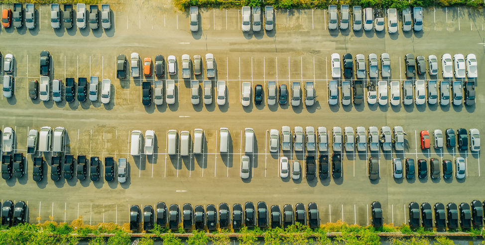 overhead view of parking lot full of cars